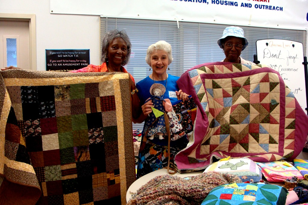 "CAPTION: Louetta Davis, Lorraine McDermott and Earthalee McPherson of the Quilting Lives group. Louetta is holding her quilt called ""Sweet & Warm"" and Earthalee is holding her quilt called ""Heritage Star"". Both quilts will be for sale at the Our Lady of Mercy 20 year Anniversary Party on October 17."