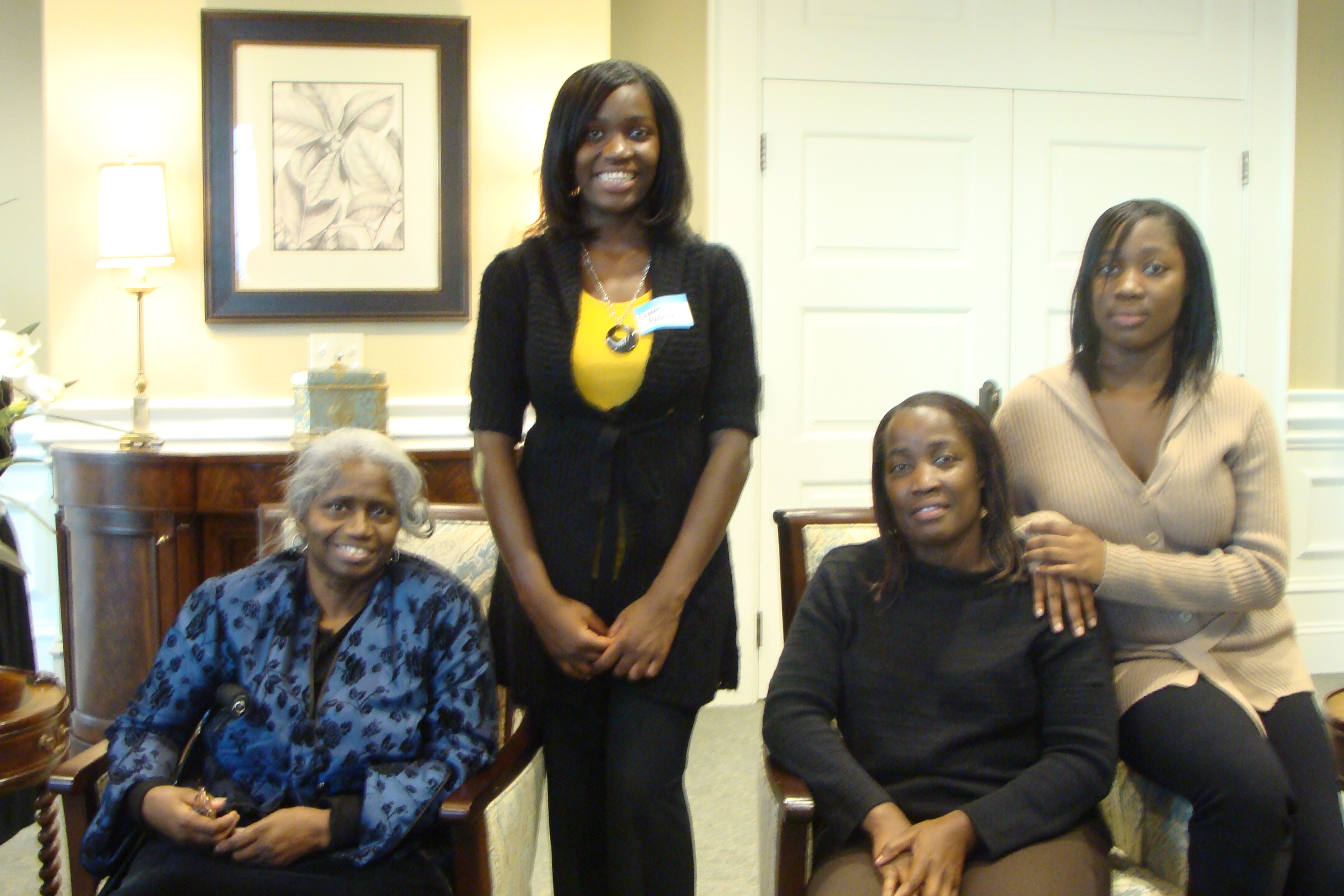 Youth of the Month Elizabeth Robinson, her family and English teacher, Ms. Moss (far left).