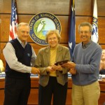 Carol Ann Smalley (center) accepts the Arts Council Service Award from Mayor Wert (left) and Arts Council Chairman Charles Lipuma (right).
