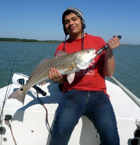 spottailed bass and guy with hat