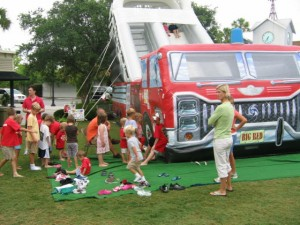 kids on inflatable fire truck