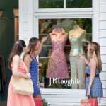 Young fashionistas admire the latest trends from J. Mclaughlin.