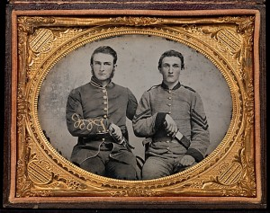 "Captain Charles A. and Sergeant John M. Hawkins, Company E, ""Tom Cobb Infantry,"" Thirty-eighth Regiment, Georgia Volunteer Infantry] (1861–62) Ambrotype, Quarter-plate; applied color; David Wynn Vaughan Collection. (Photo by Jack Melton)."