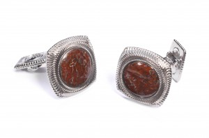 These cufflinks are inlaid with 100 million year-old fossil Apatosaurus bone.