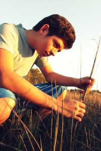 """Alex Tovar and a snail in the spartina grass"""