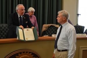 Van McCollum, new Kiawah Island Resident,  receives recognition from Cumming, Georgia Mayor H. Ford Gravitt for his nine years of service as founder, artistic director and conductor of the Cumming Playhouse Singers, during the Cumming City Council meeting on April 21.