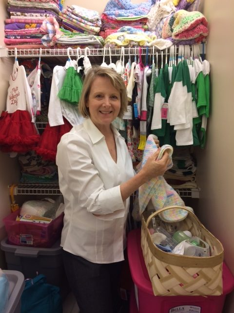 Lindy Carter in the clothing room at OLMCO.
